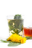 Dandelion herbal tea with green leaf in tea cup on white background Stock Photo
