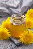 Dandelion honey in a jar. And fresh flowers Stock Photos