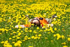 Dandelion meadow. Portrait of person on the dandelion meadow royalty free stock images