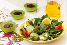 Dandelion salad with olive oil Royalty Free Stock Photo