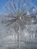 Dandelion shaped fountain. Spherical fountain with metallic spokes Royalty Free Stock Image