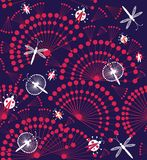 Dandelions flowers with dragonflies. Dandelions flowers in purple and white with dragonflies and butterflies. A seamless pattern on a dark blue background Royalty Free Stock Photography
