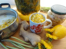 Dandelions flowers drink wine. Ginger, lemon, wild plants recipes, cooking healthy food stock photography