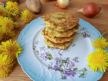 Dandelions flowers with potatoes and onion burgers Royalty Free Stock Photo