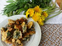 Dandelions flowers tempura. Wild plants recipes, cooking healthy food stock photo