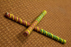 2 Dandiya sticks criss-crossed. Dandiya is the traditional folk dance of the state of Gujarat in India. 2 Dandiya sticks criss-crossed. Dandiya is the Stock Photography