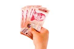Dando o dinheiro Fotos de Stock Royalty Free