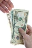 Dando o dinheiro Imagens de Stock Royalty Free