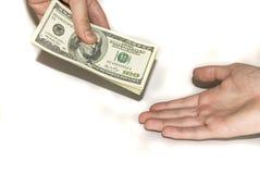 Dando o dinheiro em uma mão Foto de Stock Royalty Free