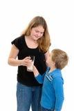 Dando o leite da criança imagens de stock royalty free