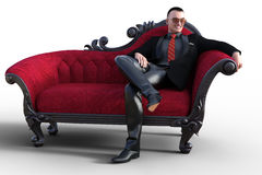 Dandy in black in red victorian sofa Royalty Free Stock Image