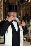 Dandy toast. Dandy figure toasting with champaign Stock Photo