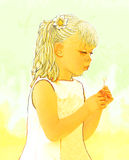 Dandylion Blower. A young girl blowing a dandylion on a hot summers day Royalty Free Stock Photo