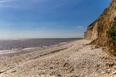 Danes Dyke, East Riding of Yorkshire, UK. North sea coast with the pebble beach and cliffs of Danes near Bridlington, East Riding of Yorkshire, UK stock photography