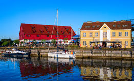 Danes river walking area. Colorful facades of antique buildings with yachts at the pier. Klaipeda, lithuania. Royalty Free Stock Image