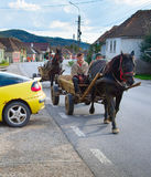 Romanians driving horse cart. Romania Royalty Free Stock Image