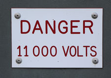 Danger 11000 Volts. Clear sign of danger 1100 volts Royalty Free Stock Photography