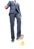 Danger. A business man about to step in banana peel Stock Photography