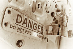 Danger. Processed photograph of a danger sign found on an old jet-fighter seat Stock Photography