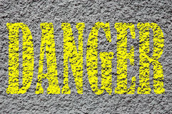 Danger. Yellow text on the rough wall vector illustration