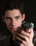 Danger. A man in the dark with a gun stock images