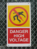 Danger. High voltage sign on a fence Royalty Free Stock Image