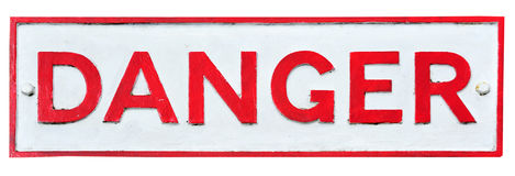 Danger. A cast-iron 'danger' sign, isolated on white Royalty Free Stock Image