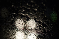 Danger abstract night driving. Dangerous abstract night driving on rainy city street royalty free stock photos