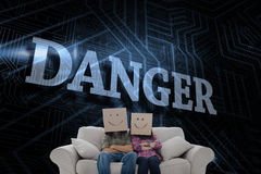 Danger against futuristic black and blue background Stock Image