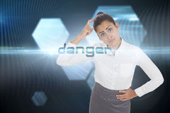 Danger against shiny hexagons on black background Royalty Free Stock Photo