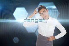 Danger against shiny hexagons on black background Royalty Free Stock Photo