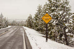 Danger Ahead. A road sign warns against some undefined danger on a snowy day stock photo