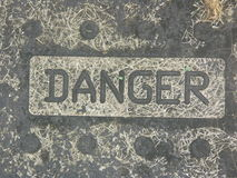 Yaletown loft art- Danger art sign. Yaletown lofts are buildings usually made of cement that are for artists to live and work. The loft suits concrete stamped stock photography