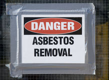Danger Asbestos Removal. Sign posted on school window Royalty Free Stock Images