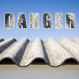 Danger asbestos roof concept Stock Photography