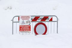 Danger of avalanche sign in the snow royalty free stock photo