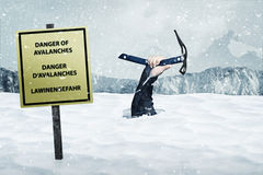 Danger of Avalanches. A man sinking under Avalanche Stock Photo