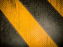 Danger background. On steel plate background Stock Photography