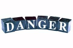 Danger. Beautiful shot of danger written on black blocks Stock Photography