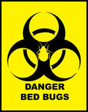 Danger BedBugs Hazard. Yellow sign with black hazard symbol and danger bed bug caution royalty free stock images