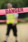 Danger Boundary Tape in a Field. Royalty Free Stock Photography