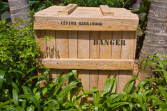 Danger box. Hiding between the tree Stock Photography
