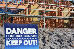 Danger building site sign. In a new home construction site. Concept photo of Building a new home,mortgage, finance, economy, market, construction work, health Royalty Free Stock Photo