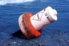 Danger Buoy Toppled. Danger buoy in Lake Erie toppled on shore Stock Image