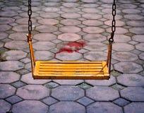 Danger cement floor for children's swing playground Stock Image