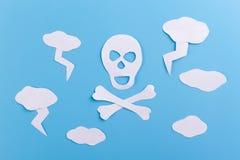 Danger concept image. Skull and lightnings stock image