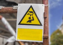 Danger construction yellow sign on construction site Royalty Free Stock Photo