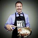 Danger, cuisson d'hommes Images stock