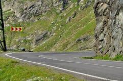 A Dangerous Curve with curve chevrons. High alpine road from Romanian Carpathians- Transfagarasan royalty free stock photos