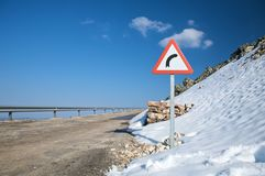 Danger curve and snow Stock Photos